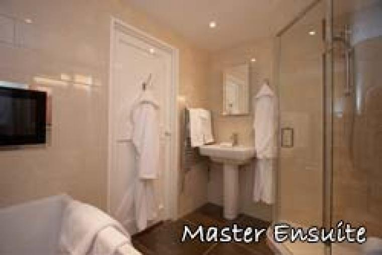 Master suite with TV included in 5 Star luxury cottages Norfolk