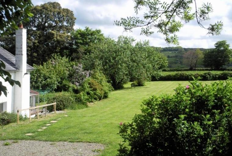 Looking down the garden next to the cottage
