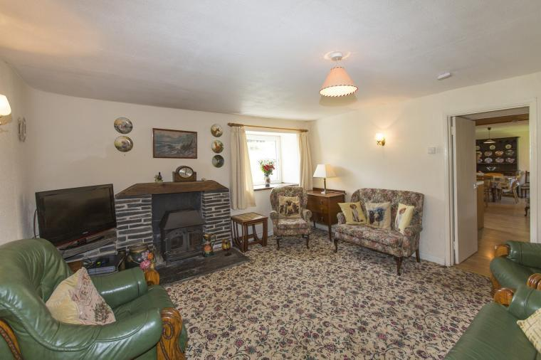 The sitting room has a log burner, Sky + films and sports and wifi
