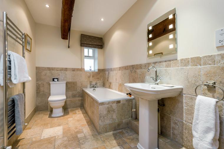 bathroom with tiled walls
