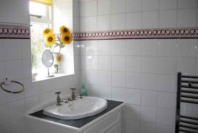 spacious shower room with heated towel rail