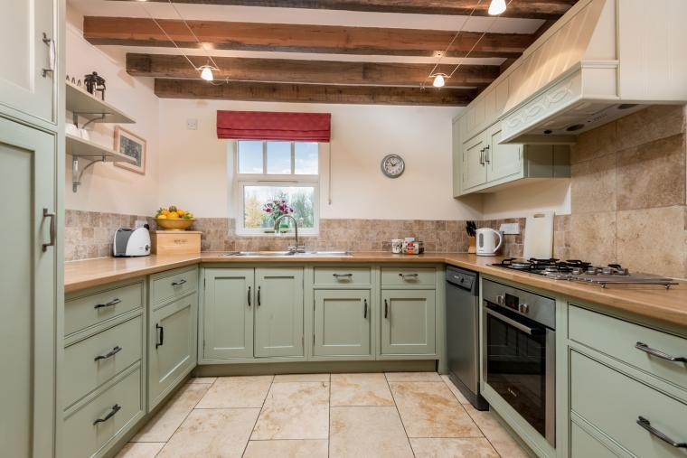 green fitted kitchen