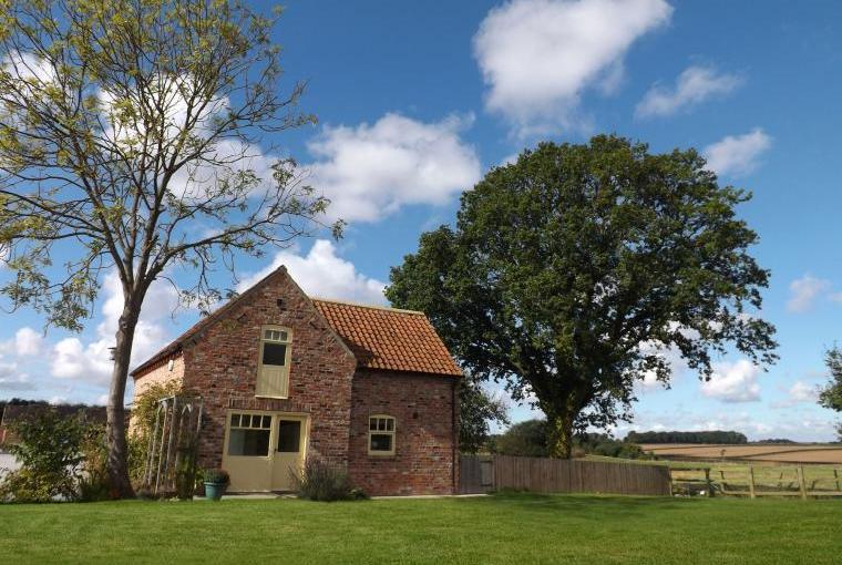 Brick cottage with fields around