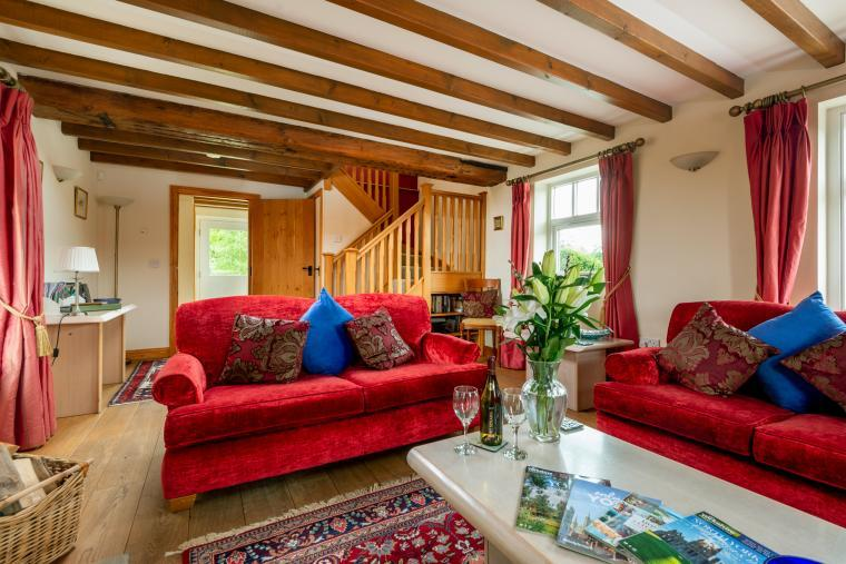 room with beams and sofas