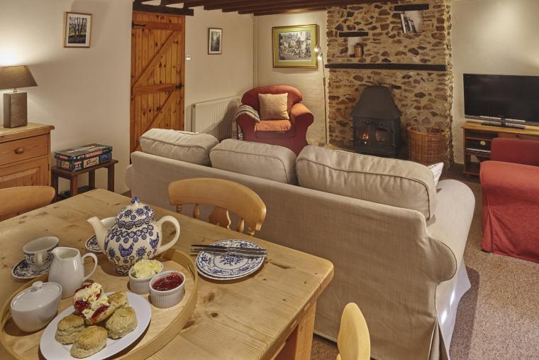 Settle in for tea in front of the wood burning stove