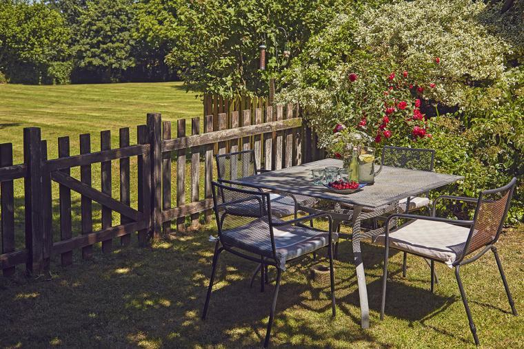 Enjoy a meal outside with a view of the meadow