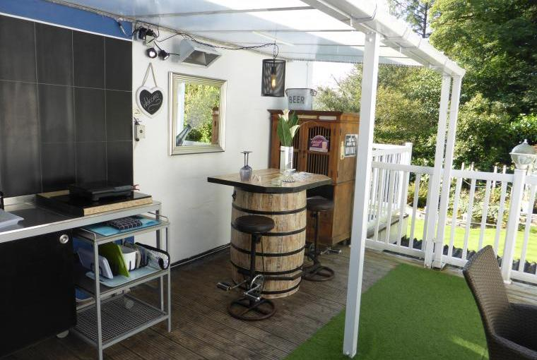 Outdoor kitchen and barrel bar under cover