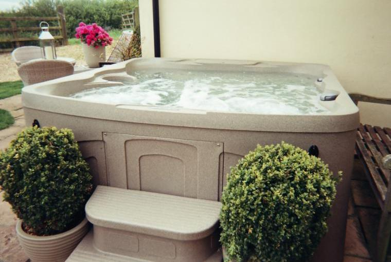 large hot tub  convenirntly place out side the garden room