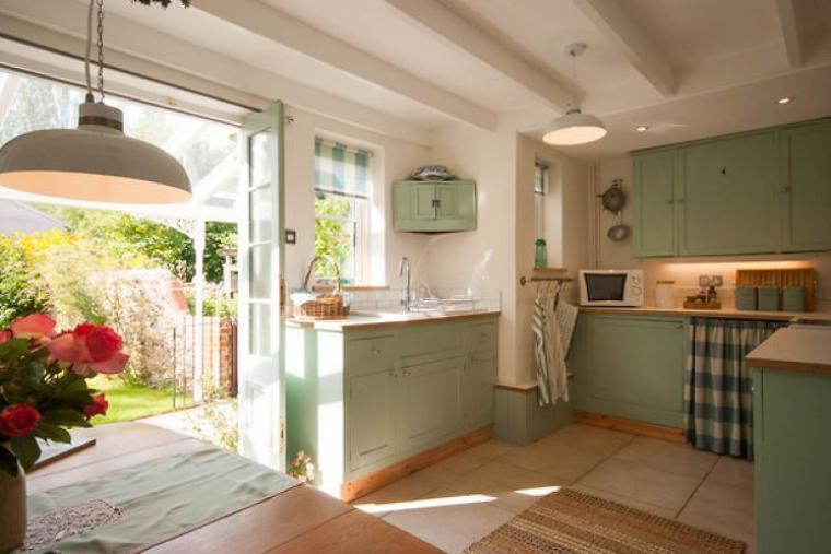 Beautiful country style kitchen with French doors opening to the garden