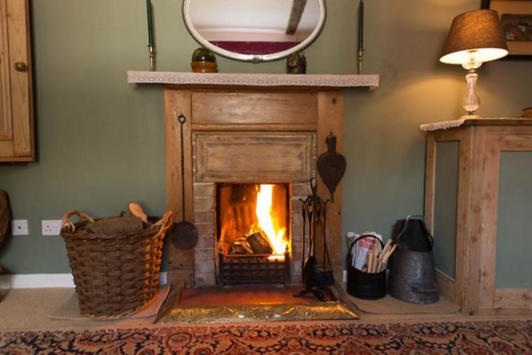 Relax by the open fire in the sitting room