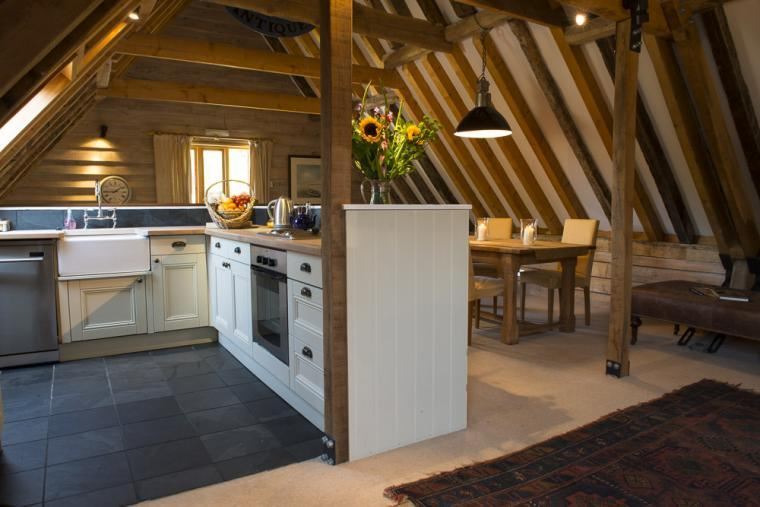 Wonderful beamed interiors in the open floor plan cottage