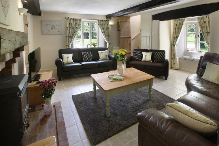 A Comfortable and Cosy Sitting Room With Space For Everybody And Wood Burning Stove