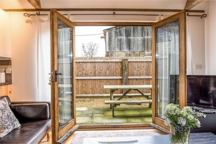 French doors from The Barn to bbq and patio