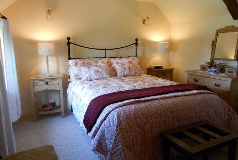 Romantic double bedroom with countryside views