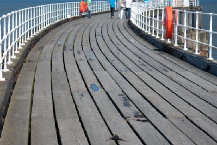 Walk along the west pier and then carry on onto the wooden extension. If you are feeling brave venture down the ladder onto the bottom  level