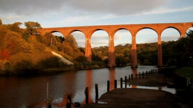The old disused viaduct spanning the river Esk