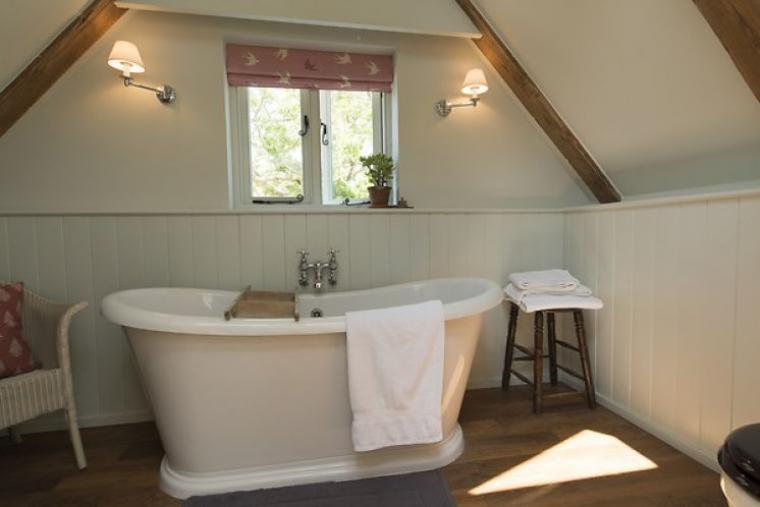 En-suite bathroom with beautiful roll top bath
