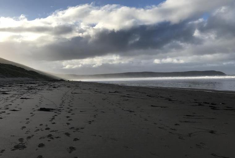 Deserted, windswept Woolacombe Beach in Winter