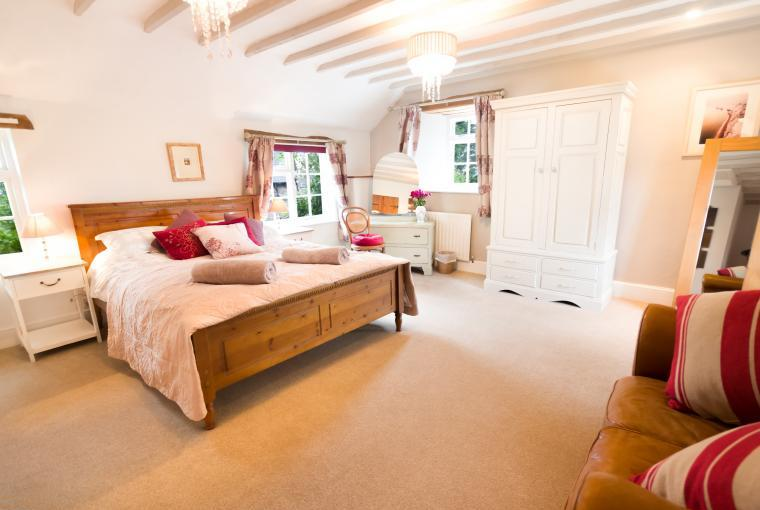 A light and spacious bedroom with King-size bed, wardrobe and dressing table
