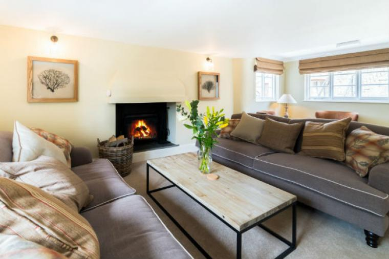 Beautifully furnished lounge with open fire