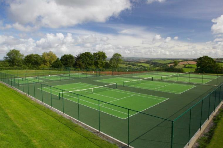The tennis courts at nearby Highbullen Hotel Golf and Country Club