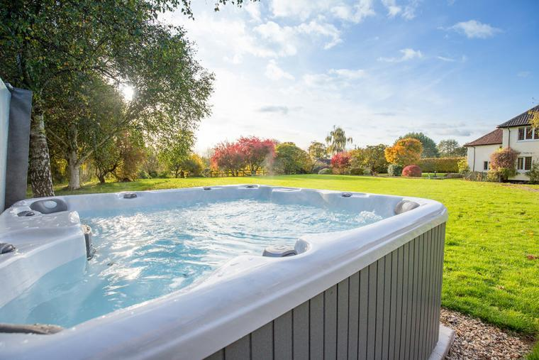 Warm bubbly hot tub on site