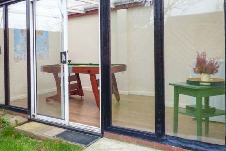 Garden room with snooker table