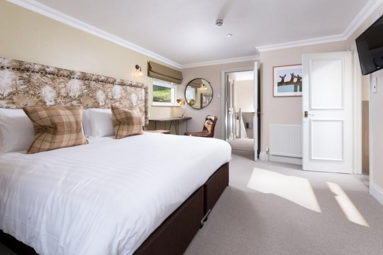 Master bedroom with king-size bed and en-suite shower room
