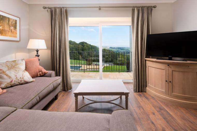 Stylish living area with balcony and superb countryside views