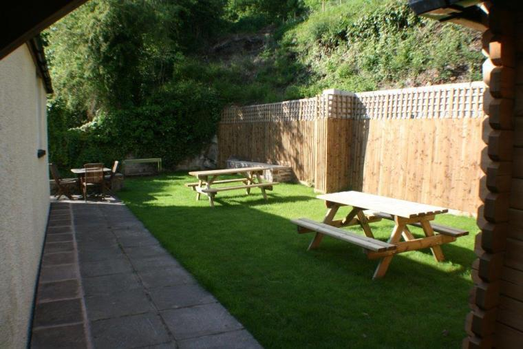 rear garden with tables and barbecue