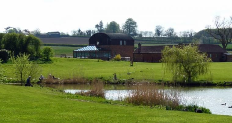 Cabins beside a fishing lake, Leicestershire, Photo 2