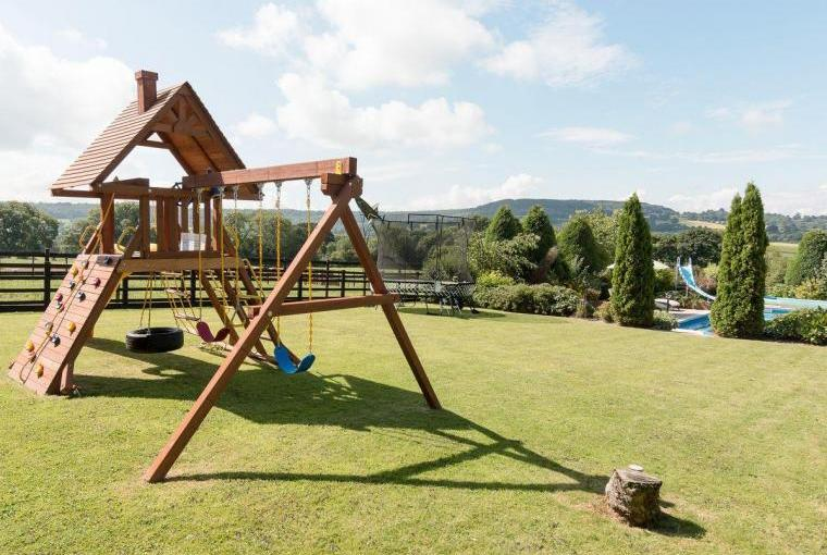 Garden With Children's Play Equipment