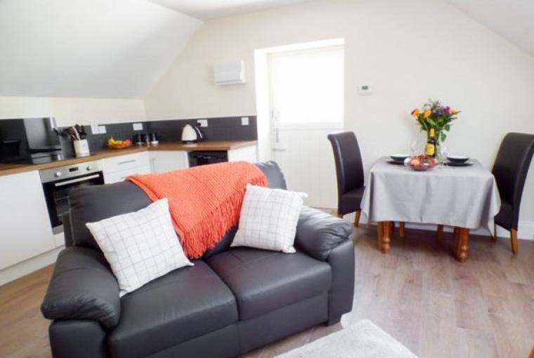 Open plan living area, Hayloft Couple's Barn Apartment, Pembrokeshire, Wales
