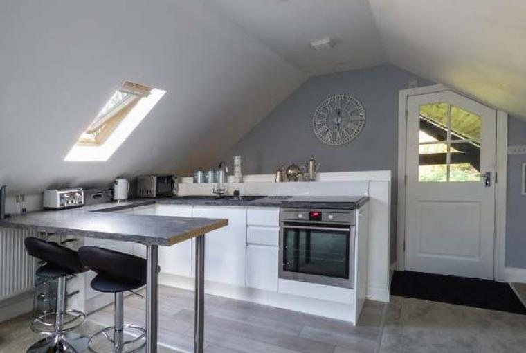 Stylish kitchen area with breakfast bar