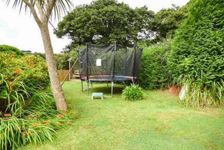 Trampoline in garden