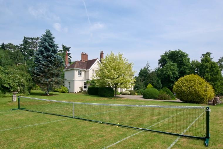 Grass tennis lawn at Ludlow Manor House