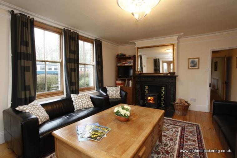 High Mill lounge, log burner, games, television and nymr carriages