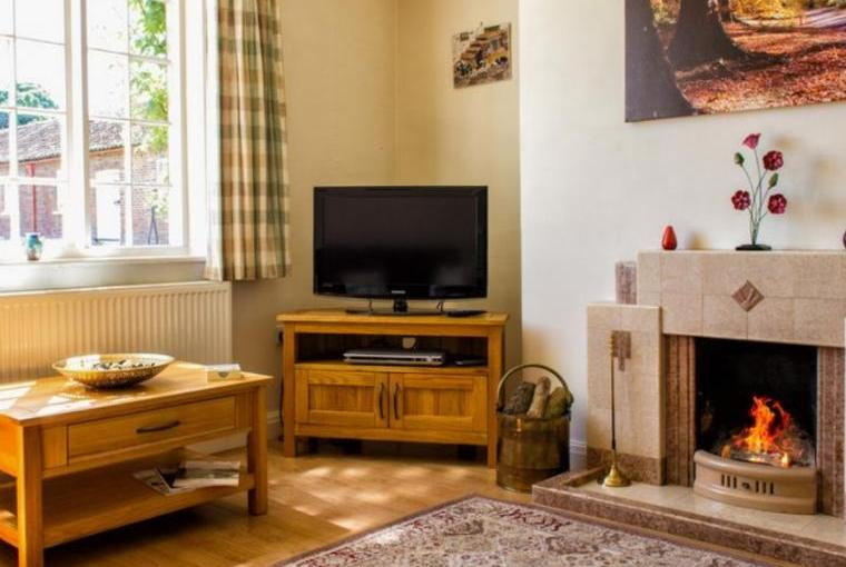 Sitting room has 2 comfy leather sofas, free view TV, DVD player and and log fire