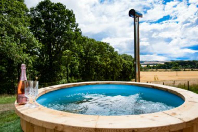 Inviting warm bubbly outdoor hot tub at Eden Hideaway