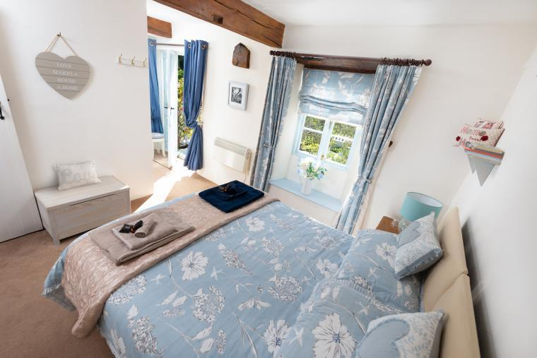 Double bedroom with small king-sized bed