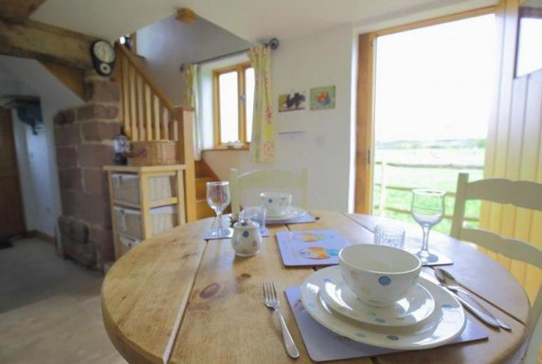 Dining area looking out to stunning view via door