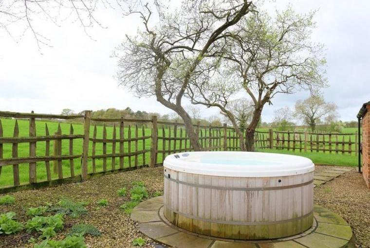 Outdoor hot tub with views over fields
