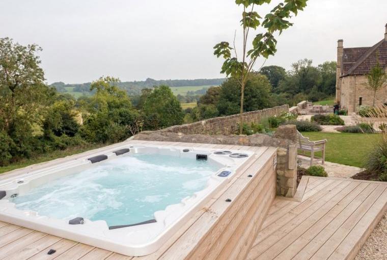 Warm bubbly outdoor hot tub at Week Farm