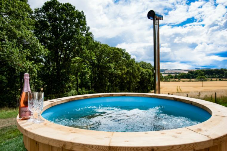 Warm bubbly hot tub, Orchard Hideaway