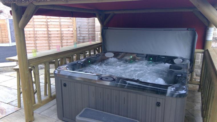 Inviting warm bubbly outdoor hot tub