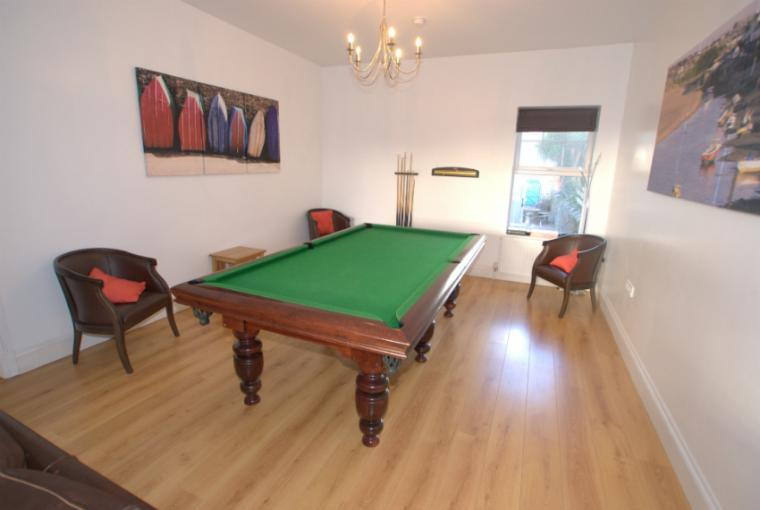 Games room with half sized snooker table
