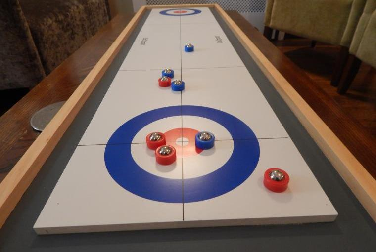 Forest House - Games Lounge shuffleboard