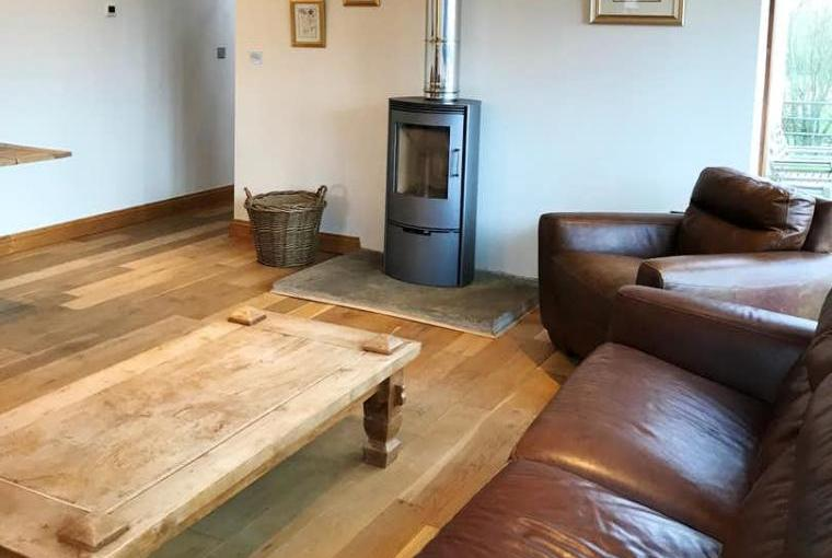 Sociable lounge with country views and warming woodburner