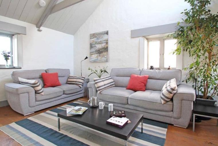 Comfy lounge area with vaulted ceiling