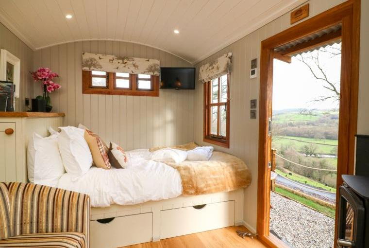 King-size romantic bed and lush countryside views